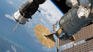 In this June 24, 2018 photo released by NASA, the Russian Soyuz MS-09 crew craft, left, and the Northrop Grumman (formerly Orbital ATK) Cygnus space freighter are attached to the International Space Station. NASA and Russian space officials stressed Thursday, Aug. 30, 2018, that the six astronauts are in no danger after a small air leak developed in one, at left, of the two Soyuz capsules docked at the space station. Russian officials say the leak was detected Wednesday night and may be the result of a micrometeorite impact. Both the crew and ground controllers are working hard to isolate the leak. (NASA via AP)