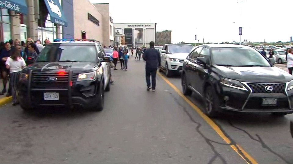 A police cruiser is parked outside Yorkdale Shopping Centre after gunshots were fired inside the mall.
