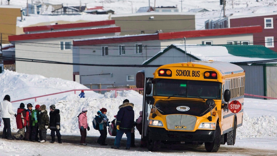 Students board a school bus at the Nakasuk Elementary School in Iqaluit, Nunavut, in a March 30, 2009, file photo. THE CANADIAN PRESS/Nathan Denette