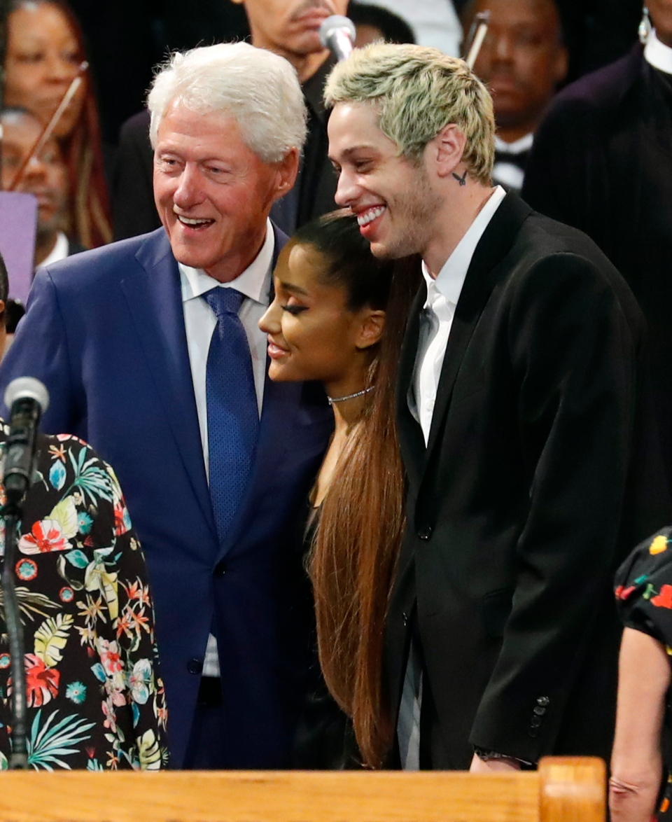 Former U.S. President Bill Clinton poses for a photo with Ariana Grande, centre, and Pete Davidson, right, during the funeral service for Aretha Franklin at Greater Grace Temple, Friday, Aug. 31, 2018, in Detroit. (AP Photo/Paul Sancya)