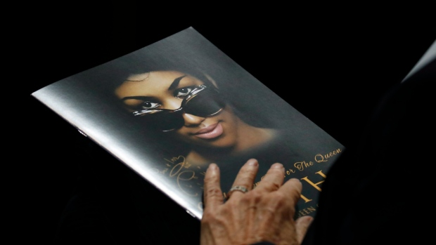A person holds a program during the funeral service for Aretha Franklin at Greater Grace Temple, Friday, Aug. 31, 2018, in Detroit. (AP Photo/Paul Sancya)