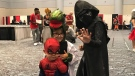 Fans dressed as Spider-man, the Lizard and Kylo Ren at Fan Expo Canada in Toronto, Friday, Aug. 31, 2018.