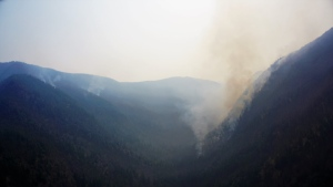 Smoke rises from the Snowy Mountain wildfire as seen in a photo posted Aug. 14, 2018.