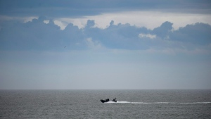 A security boat patrols the St. Lawrence River along the perimeter of the G7 Leaders Summit in La Malbaie, Quebec on Thursday, June 7, 2018. (THE CANADIAN PRESS/Sean Kilpatrick)