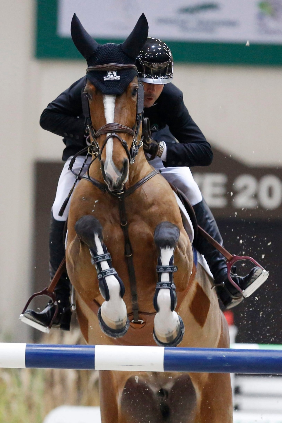 Eric Lamaze from Canada rides his horse Fine Lady 5 during the final ceremony of the 16th top 10 IJRC, International Jumping Riders Club, at the 56th CHI international horse show jumping tournament in Geneva, Switzerland, Friday, Dec. 9, 2016. Lamaze took first place. (Magali Girardin/Keystone via AP)