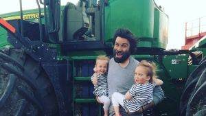 Organic farmer Travis Heide poses with his daughters, twins Audrey, and Gia, 6, near Melfort, Sask., in this undated handout photo. (THE CANADIAN PRESS / HO - Travis Heide)