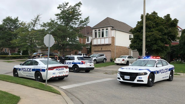 Emergency crews are seen investigating a fatal shooting in the area of Sunforest Drive and Sandalwood Parkway East in Brampton, Ont.