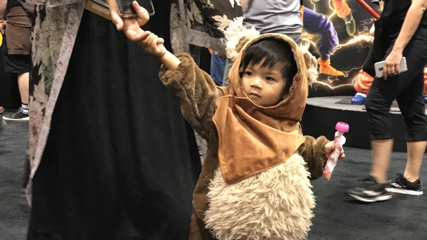 A kid walks the convention floor dressed as an Ewok from Star Wars at Fan Expo Canada.