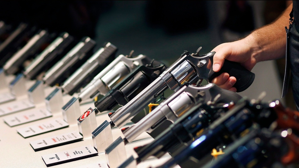 Handguns are displayed at a trade show in Las Vegas on Jan. 19, 2016. (AP Photo/John Locher)