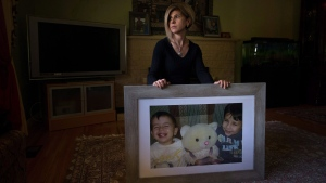 Tim Kurdi sits for a photograph with a photo of her late nephews Alan, left, and Ghalib Kurdi at her home in Coquitlam, B.C., on Monday August 22, 2016. THE CANADIAN PRESS / Darryl Dyck