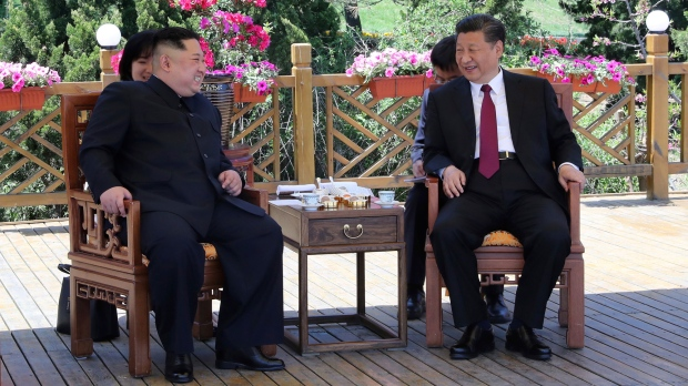China's Xi Jinping and Kim Jong Un