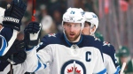 Winnipeg Jets forward Blake Wheeler (26) is congratulated after scoring a goal against the Minnesota Wild in the first period of an NHL hockey game on Sunday, April 15, 2018, in St. Paul, Minn. THE CANADIAN PRESS/AP, Andy Clayton-King