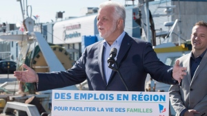 Quebec Liberal Leader Philippe Couillard responds to reporters questions during a news conference Tuesday, September 4, 2018 in Gaspe Que. THE CANADIAN PRESS/Jacques Boissinot