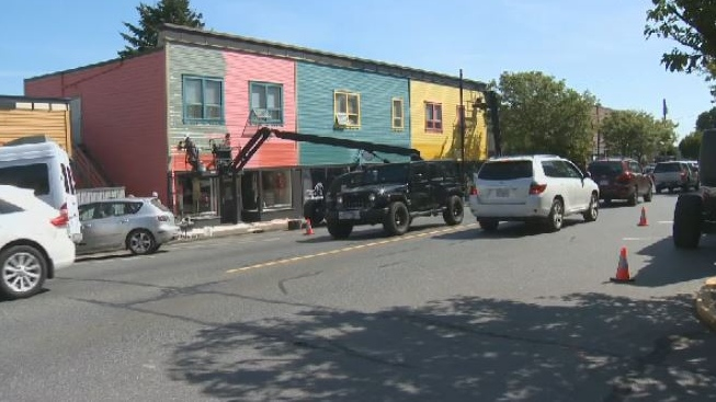 Crews spent the day slapping a fresh coat of paint on buildings along 1st Avenue in Ladysmith ahead of the rodent's arrival. Sept. 4, 2018. (CTV Vancouver Island)