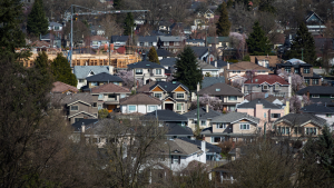 A condo building is seen under construction surrounded by houses in Vancouver, B.C., on March 30, 2018. ( THE CANADIAN PRESS/Darryl Dyck)