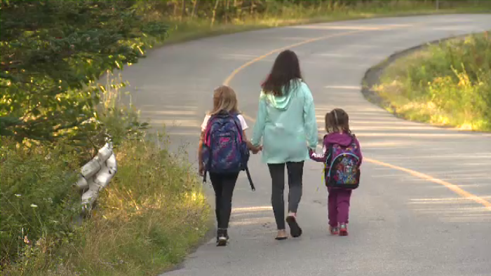 It was a long road to get to the bus stop for Anastasia Tsagaris and her kids Athena and Alexandra.