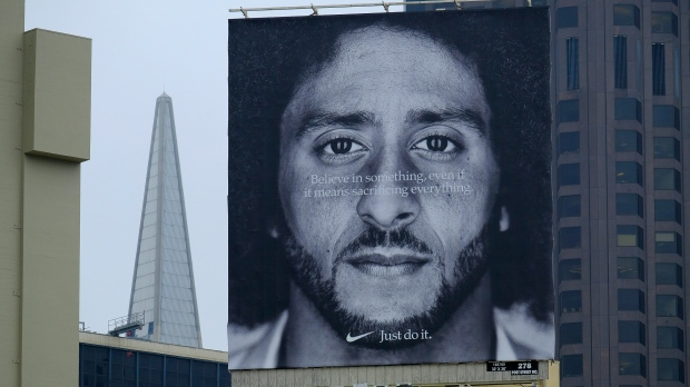 93191ecc5cc A large billboard stands on top of a Nike store showing former San Francisco  49ers quarterback Colin Kaepernick at Union Square, Wednesday, Sept.