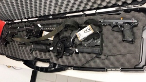 An unlocked case of guns sent to a Bombardier facility in Toronto is seen here. The CBSA is investigating how the guns ended up at their destination.