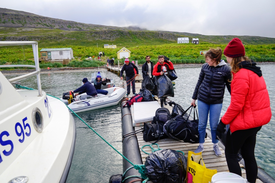 In this Wednesday Aug. 8, 2018 photo, hikers and local summer residents prepare to board the Hornstrandir passenger ferry connecting the remote peninsula, only accessible by boat, to Iceland's northwestern region. (AP Photo/Egill Bjarnason)