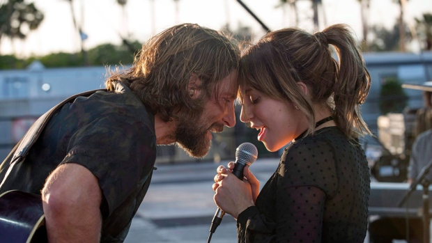 """This image released by Warner Bros. shows Bradley Cooper, left, and Lady Gaga in a scene from the latest reboot of the film, """"A Star is Born."""" World tensions are being tackled at this year's Toronto International Film Festival, which kicks off Thursday. THE CANADIAN PRESS/AP, HO, Neal Preston/Warner Bros. via AP"""