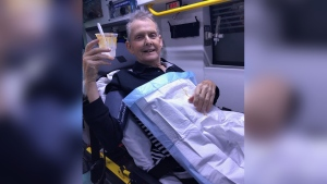 Ron McCartney finished his ice cream sundae while riding in the back of an ambulance. (Danielle Smith / Facebook)