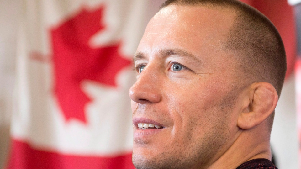 Georges St-Pierre speaks to the media after his workout Wednesday, October 25, 2017 in Montreal. (THE CANADIAN PRESS / Ryan Remiorz)