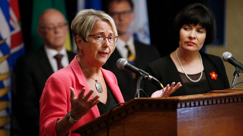 Judy Darcy, B.C.'s Minister of Mental Health and Addictions, responds to a question during a news conference in Winnipeg on June 29, 2018. THE CANADIAN PRESS/John Woods