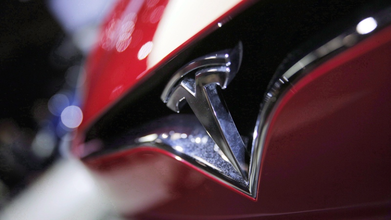 The logo of the Tesla Model S on display at the Paris Auto Show in Paris on Sept. 30, 2016. THE CANADIAN PRESS/AP, Christophe Ena