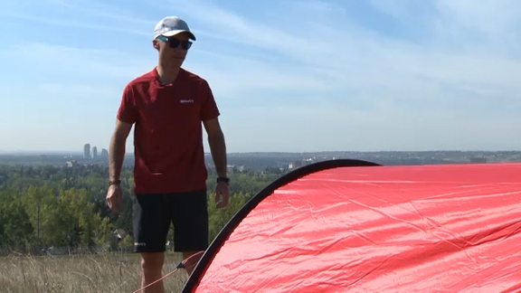 Laval St. Germain inspects his tent in Nose Hill Park ahead of his November trip to Antarctica where he plans to ski to the South Pole and then summit Mount Vinson