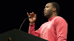 This March 24, 2014, photo provided by Harding University in Search, Ark., shows Botham Jean, speaking at the university. (Jeff Montgmery/Harding University via AP)