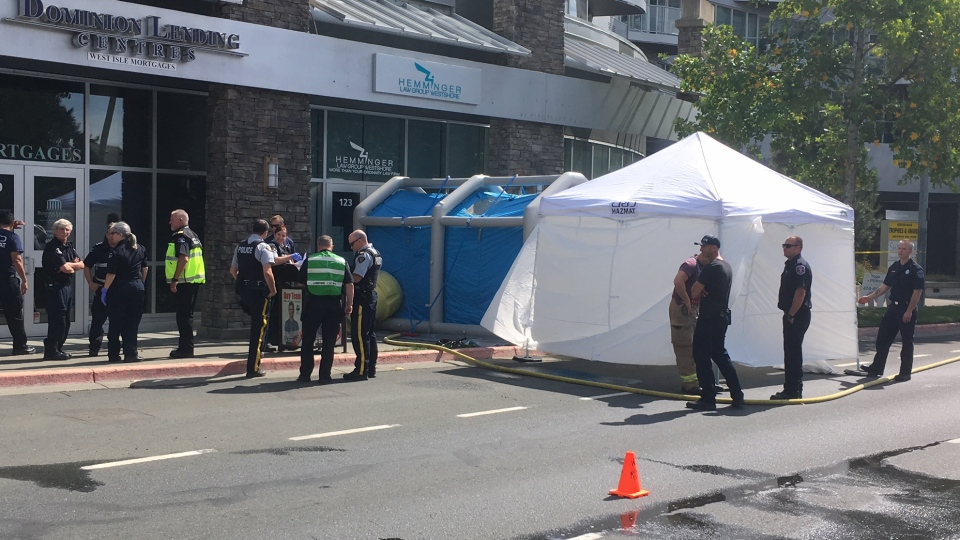 Hazmat crews set up a decontamination tent outside of Hemminger Law Group Westshore in Langford after an employee was reportedly sent an envelope with white powder in it. Sept. 7, 2018. (CTV Vancouver Island)
