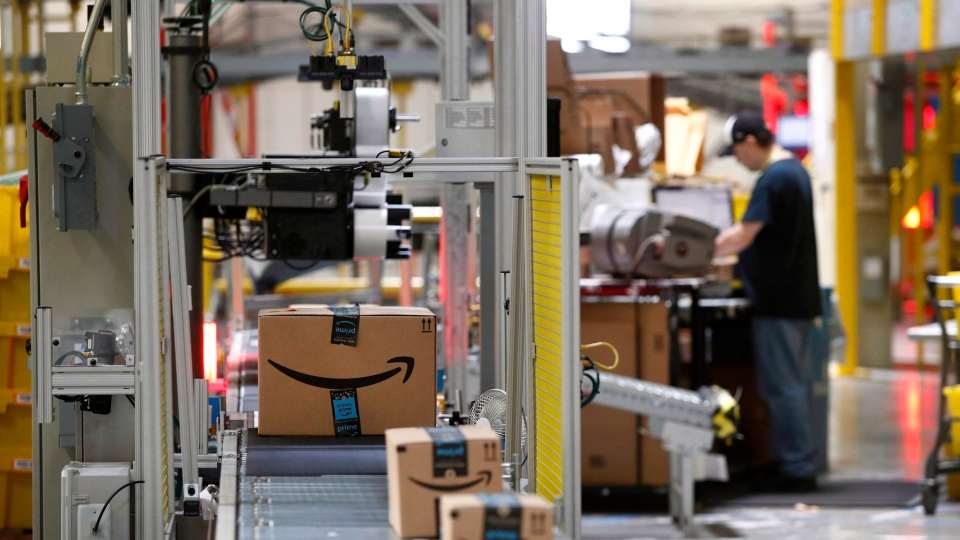 In this Aug. 3, 2017, file photo, packages pass through a scanner at an Amazon fulfillment center in Baltimore.  (Patrick Semansky/ AP Photo)