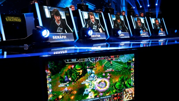 In this Aug. 29, 2014, file photo, names and faces of gamers are shown as they compete in a round of the League of Legends championship series video game competition at the Penny Arcade Expo, a fan-centric celebration of gaming in Seattle. (AP Photo/Ted S. Warren)