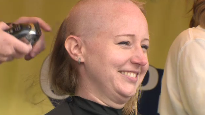 Altiera Essensa gets her head shaved at the Cops for Cancer event. (Sept. 8, 2018)