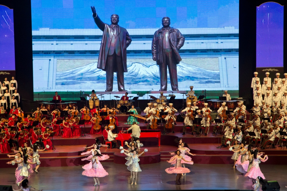 A large screen displays statues of late North Korean leaders Kim Il Sung and Kim Jong Il during a evening gala performance on the eve of the 70th anniversary of North Korea's founding day in Pyongyang, North Korea, Saturday, Sept. 8, 2018. North Korea will be staging a major military parade, huge rallies and reviving its iconic mass games on Sunday to mark its 70th anniversary as a nation. (AP Photo/Ng Han Guan)