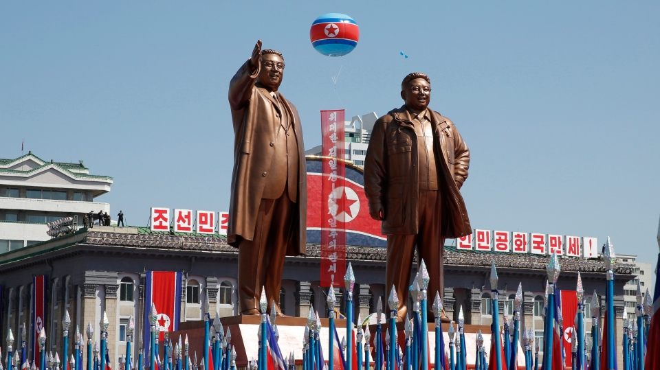 A float with statues of late North Korean leaders Kim Il Sung and Kim Jong Il rolls past during a parade marking the 70th anniversary of North Korea's founding day in Pyongyang, North Korea, Sunday, Sept. 9, 2018. (AP Photo/Kin Cheung)