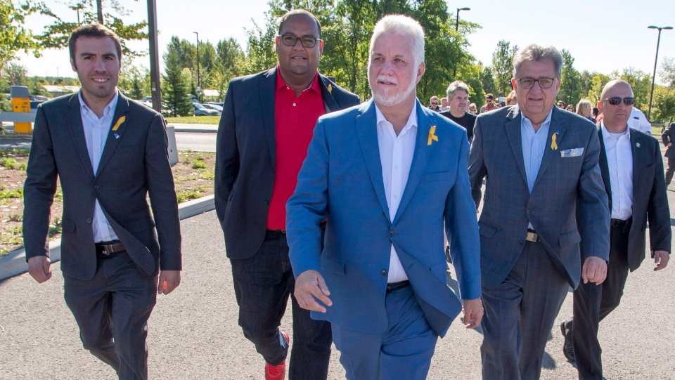 Quebec Liberal leader Philippe Couillard heads to his bus after the morning press conference while campaigning Saturday, September 8, 2018 in Montreal, Que. (THE CANADIAN PRESS / Ryan Remiorz)