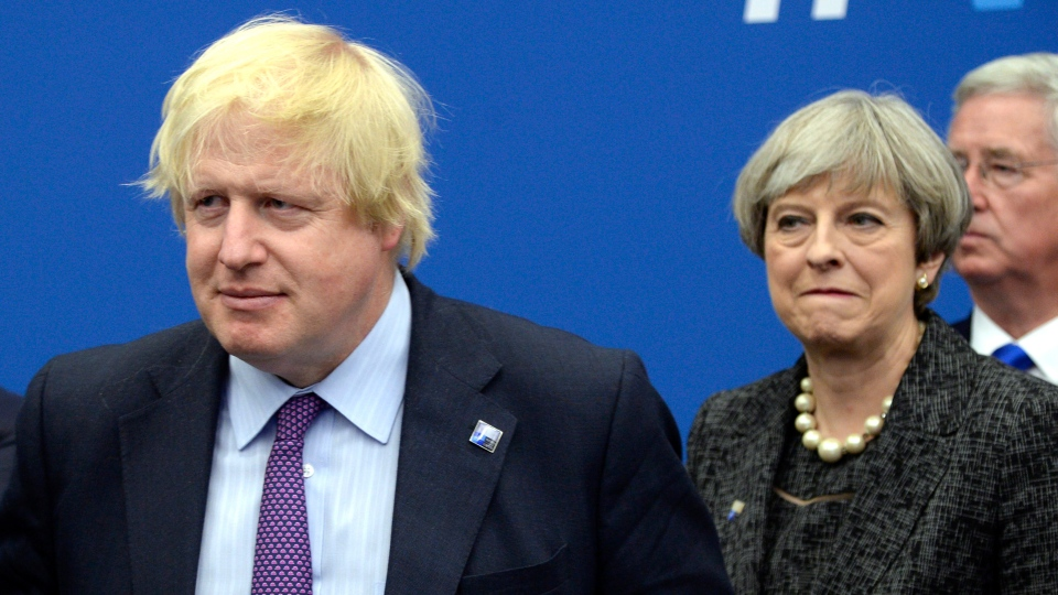 Former British Foreign Secretary Boris Johnson, left, and Britain's Prime Minister Theresa May arrive for a meeting during the NATO summit of heads of state and government, at the NATO headquarters, in Brussels May 25, 2017. (Thierry Charlier/Pool Photo via AP, File)