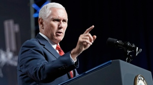 "In this Aug. 23, 2018, file photo, Vice President Mike Pence speaks during a visit to NASA's Johnson Space Center in Houston. Pence says he's ""100 percent confident"" that no one on his staff was involved with the anonymous New York Times column criticizing President Donald Trump's leadership. (AP Photo/David J. Phillip, File)"