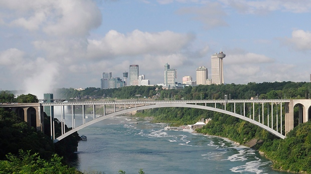 This Aug. 7, 2014 photo, shows the Rainbow Bridge which connects Niagara Falls, New York and Niagara Falls, Ontario, Canada.  (AP Photo/The Niagara Gazette, Dan Cappellazzo)