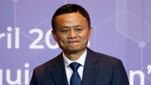 In this Thursday, April 19, 2018 file photo, Founder and chairman of Alibaba Jack Ma leaves a signing ceremony of the memorandums of understanding linked to the investment in the country in Bangkok, Thailand. (AP Photo/Sakchai Lalit, File)