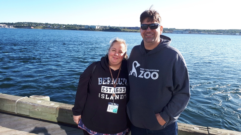 Christi Legare and her husband Daniel pose on the Halifax waterfront on Sunday, Sept.9, 2018. Cruise ship passengers who planned on a warm-weather vacation but ended up in Atlantic Canada instead say they're disappointed about the last-minute change in plans, but they understand the need to put safety first. (THE CANADIAN PRESS/Alex Cooke)
