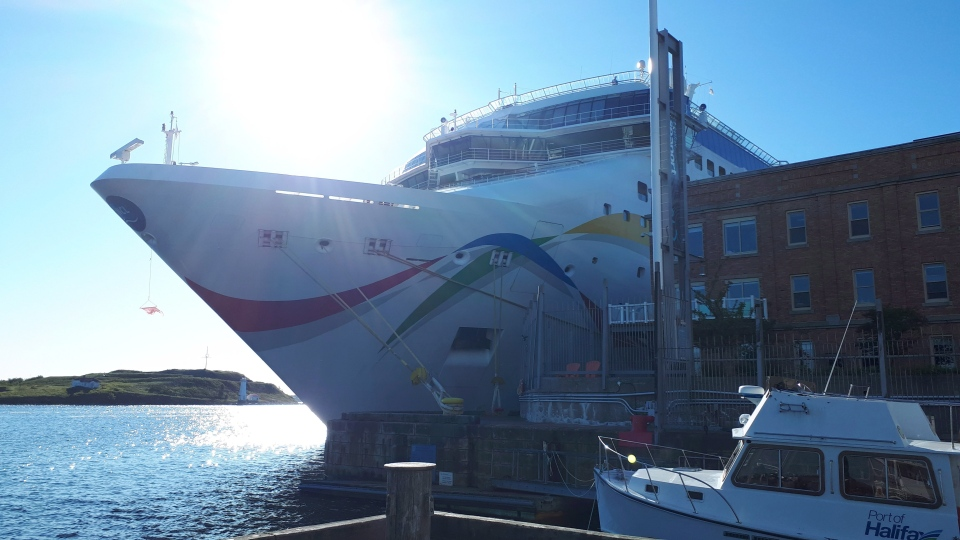 The Norwegian Dawn cruise ship is shown in Halifax, Sunday, Sept.9, 2018.Cruise ship passengers who planned on a warm-weather vacation but ended up in Atlantic Canada instead say they're disappointed about the last-minute change in plans, but they understand the need to put safety first. (THE CANADIAN PRESS/Alex Cooke)