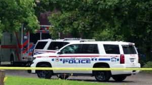 Durham Regional Police are seen investigating a fatal shooting in Clarington on Monday afternoon.