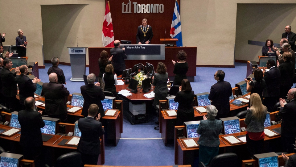 FILE -- Toronto's newly elected Mayor John Tory receives a standing ovation from the City Council in Toronto, on Tuesday December 2, 2014 . (THE CANADIAN PRESS/Chris Young)
