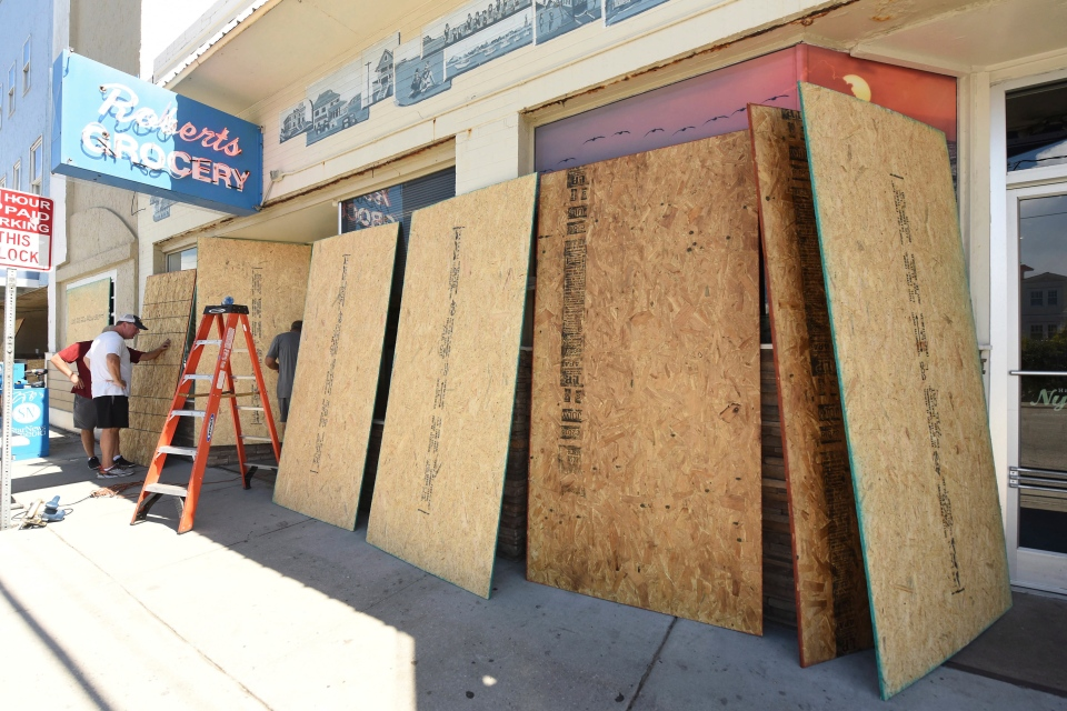 Roberts Grocery Store in Wrightsville Beach, N.C. boards up it's windows as they prepare for Hurricane Florence Monday, Sept. 10, 2018. (Ken Blevins /The Star-News via AP)