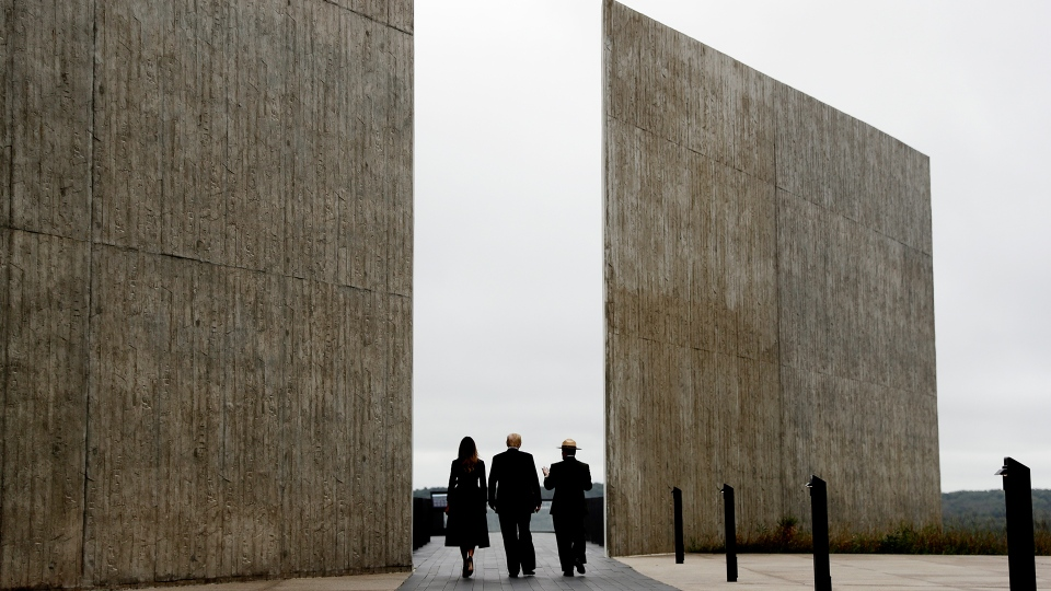 U.S. President Donald Trump and first lady Melania Trump, escorted by Stephen Clark, Superintendent of the National Parks of Western Pennsylvania, walk along the September 11th Flight 93 memorial, Tuesday, Sept. 11, 2018, in Shanksville, Pa. (AP / Evan Vucci)