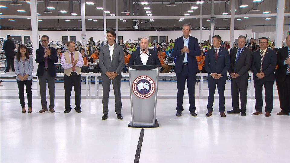 Prime Minister Justin Trudeau and Manitoba Premier Brian Pallister attend an announcement at Canada Goose in Winnipeg.