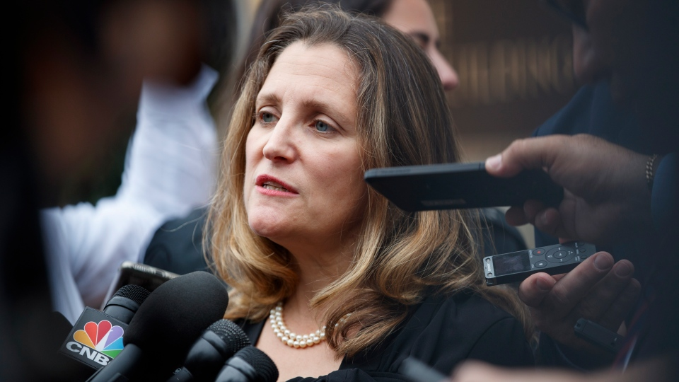 Foreign Affairs Minister Chrystia Freeland speaks to the media as she arrives at the Office Of The United States Trade Representative, Tuesday, Sept. 11, 2018, in Washington. (AP Photo/Carolyn Kaster)