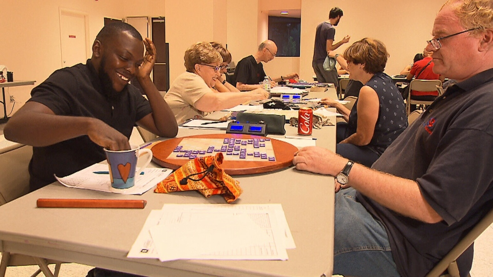 Olakunle Azeez Omopariola, an asylum seeker from Nigeria, plays a game of Scrabble in Côte-Saint-Luc, Que. (CTV News)